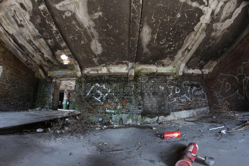 Old abandoned and broken room, warehouse hall royalty free stock photo