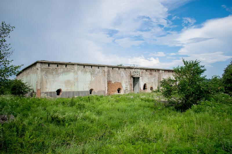 An old abandoned building. Former warehouse of fruits and vegetables in the 1980s. Holes in the walls royalty free stock photos