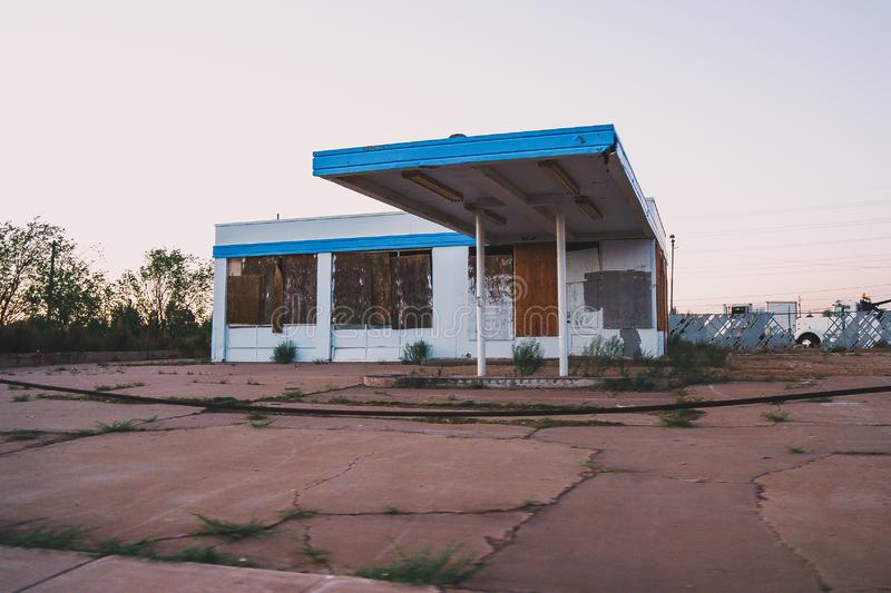 Old abandoned building, likely a gas station, in Holbrook Arizona royalty free stock photography