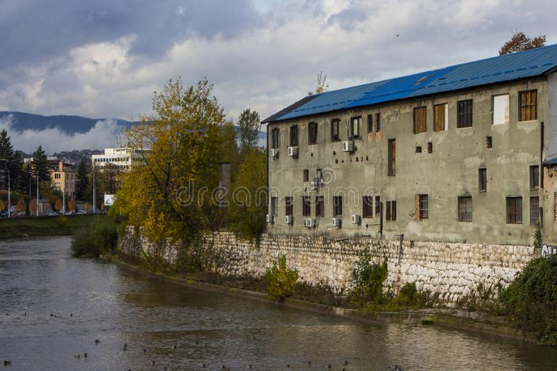 Old and abandoned buildings on the banks of the Miljacka River in Sarajevo. Bosnia and Herzegovina.  stock images