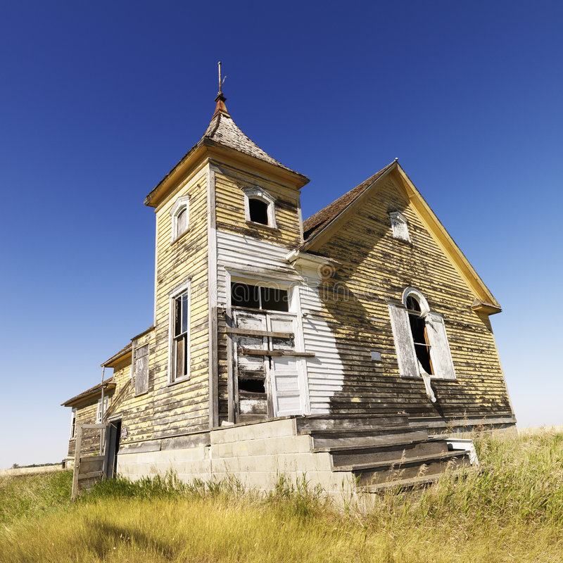 Old abandoned church. Scenic of old abandoned church in field stock photography