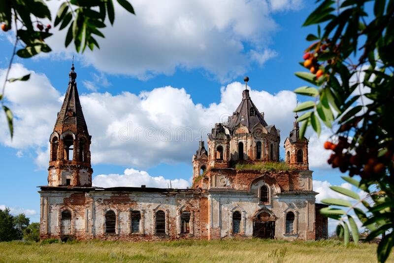 Old abandoned church on a background of blue sky on a summer day. In a Russian village royalty free stock photos