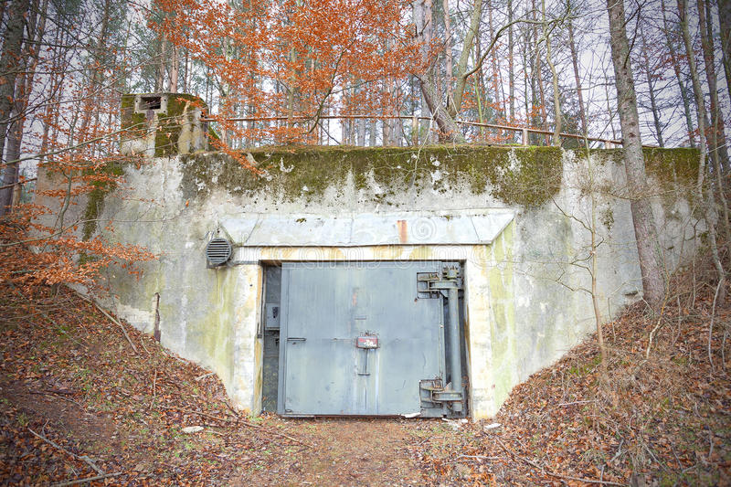 Old abandoned Cold War bunker in forest. royalty free stock photo