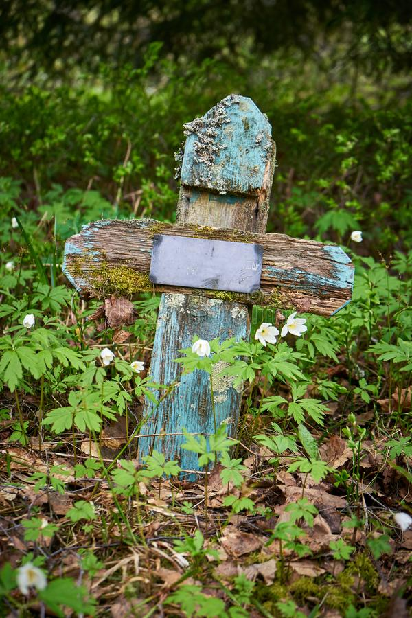 Old abandoned cross in old graveyard stock photography