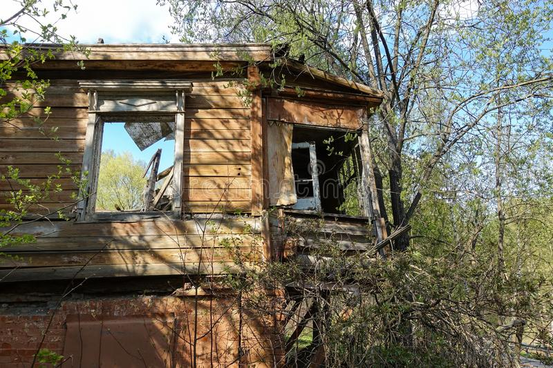 Old abandoned and destroyed log house in Russia. Abandoned house in the middle of the forest stock photos