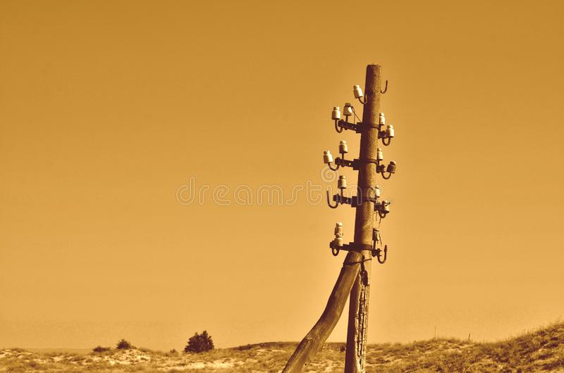 Obsolete wireless phone pole. Old abandoned electricity pylon or telephone pole with no wires or cables attached. Communication problems concept. Retro styled royalty free stock photos