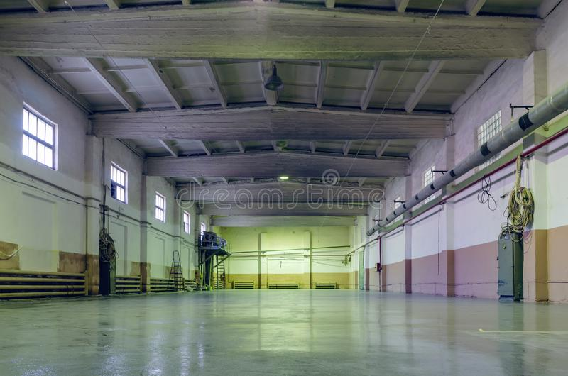Old abandoned empty production hall, factory interior.  stock photos