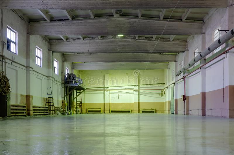 Old abandoned empty production hall, factory interior.  royalty free stock photo