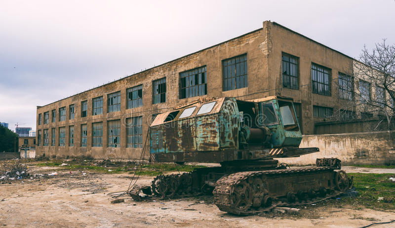 Old abandoned excavator in yard royalty free stock photo