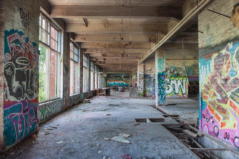 Old abandoned factory hall stock photo