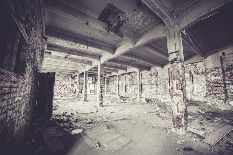 Old abandoned factory hall. And graffiti stock image