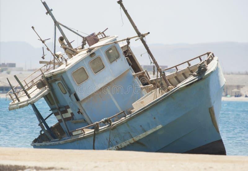 Old abandoned fishing boat wreck royalty free stock image