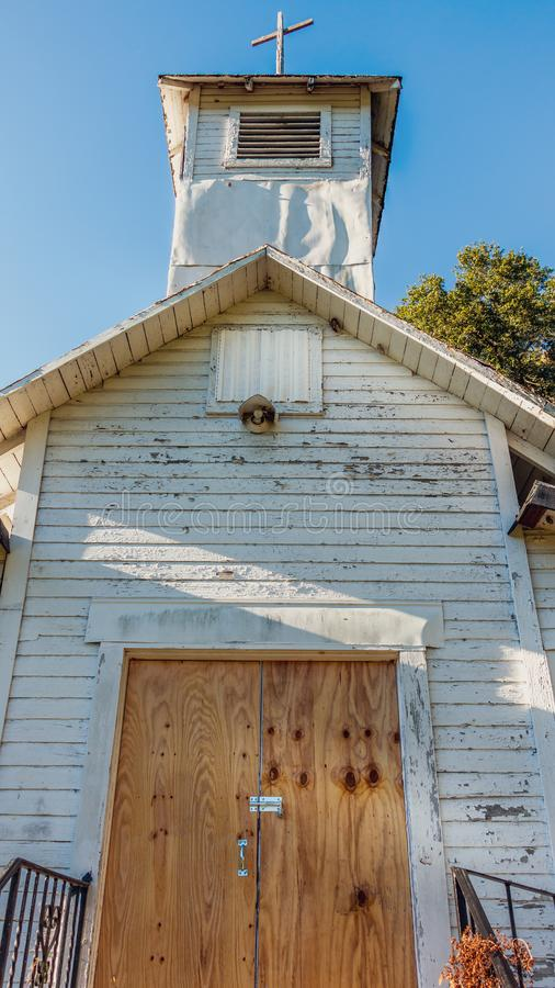 Old abandoned Florida church with locked wooden doors royalty free stock photo