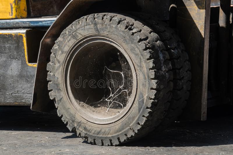 Old abandoned of forklift tire filled with spider web. Old abandoned of forklift tire filled with spider web stock photos