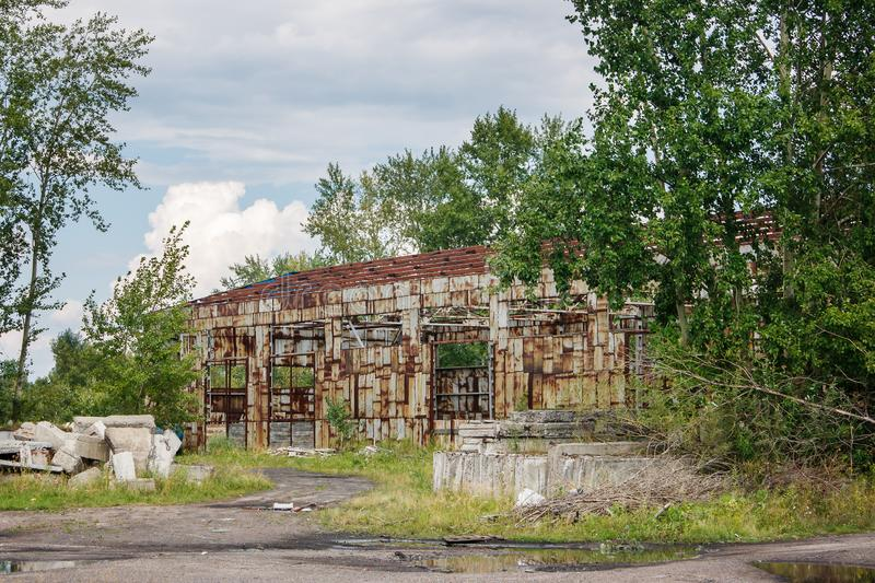 Old abandoned hangar. In siberian city on summer day stock photo