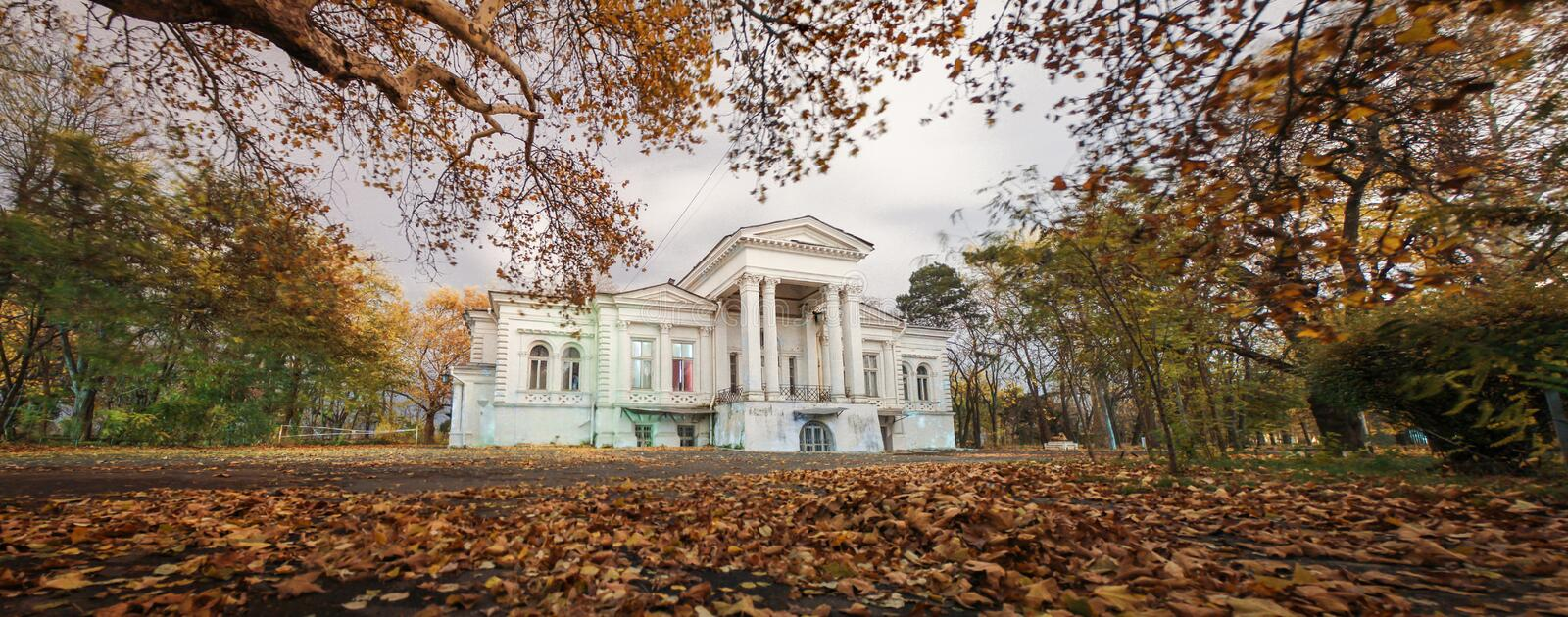 old abandoned haunted house. Fallen foliage stock images