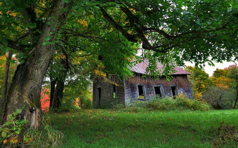 Abandoned House In Autumn. An old abandoned house beginning to collapse in the foothills of the Appalachians surrounded by early fall colors stock image