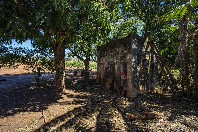 Old abandoned house in the countryside with broken roof. Brazil stock photo