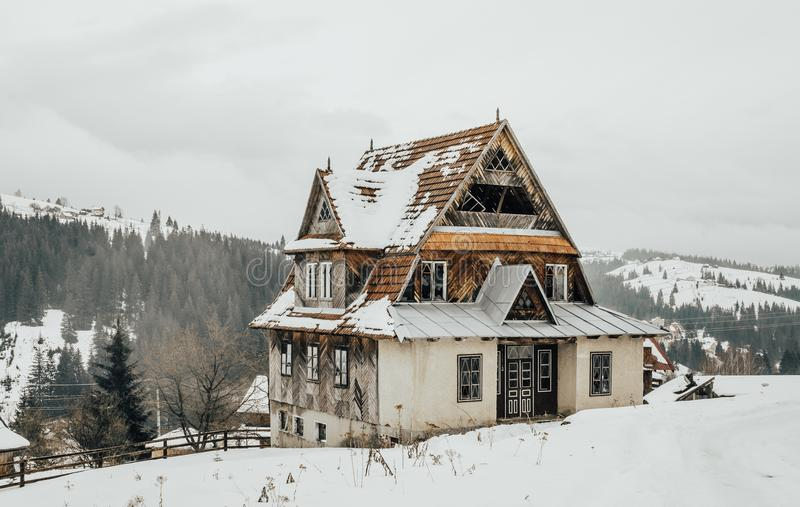 Old abandoned house on a hill. The village in the Carpathian Mountains stock photo
