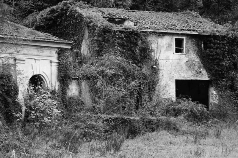 The old abandoned house in the mountains. This is a abandoned house in the mountains in black and white royalty free stock photos