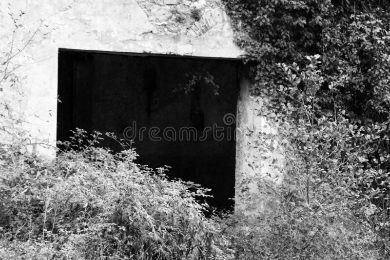 The old abandoned house in the mountains. This is a abandoned house in the mountains in black and white royalty free stock image
