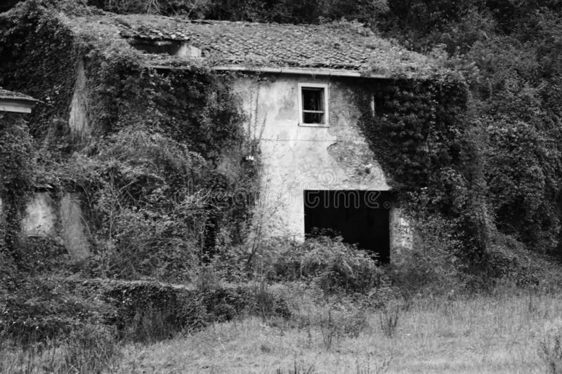 The old abandoned house in the mountains stock image