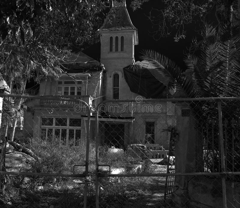 Old abandoned house at night. Picture of an old abandoned house at night. Possibly haunted royalty free stock photos