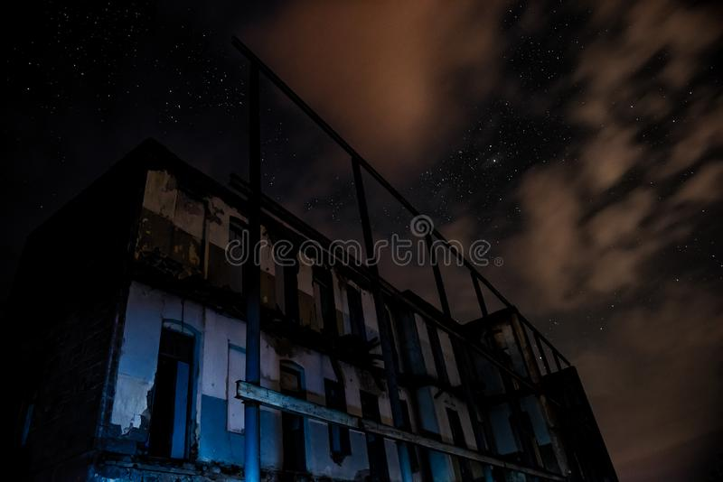 Old abandoned house at night. Time stock images