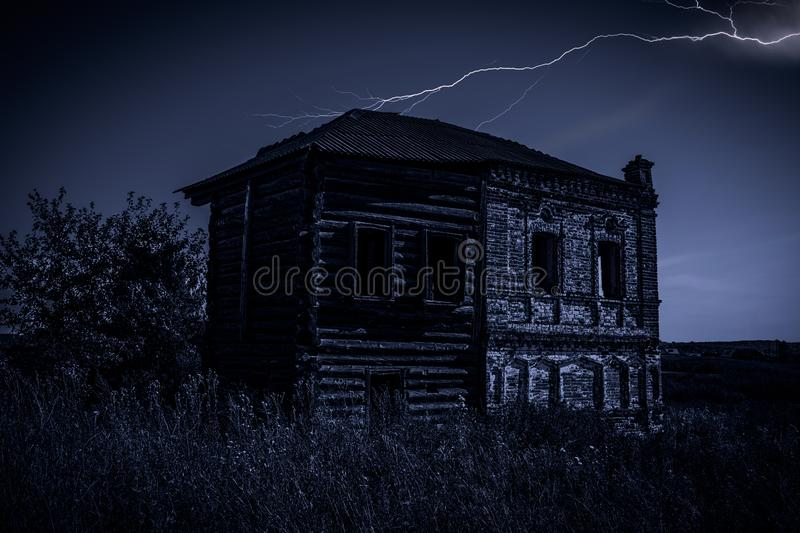 Old house at night. Old abandoned house at night during a thunderstorm royalty free stock photos