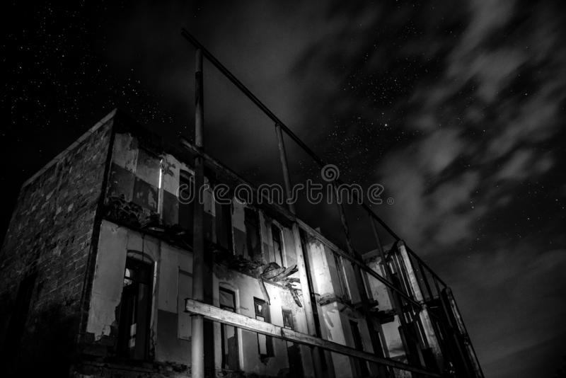 Old abandoned house at night. Time stock photo