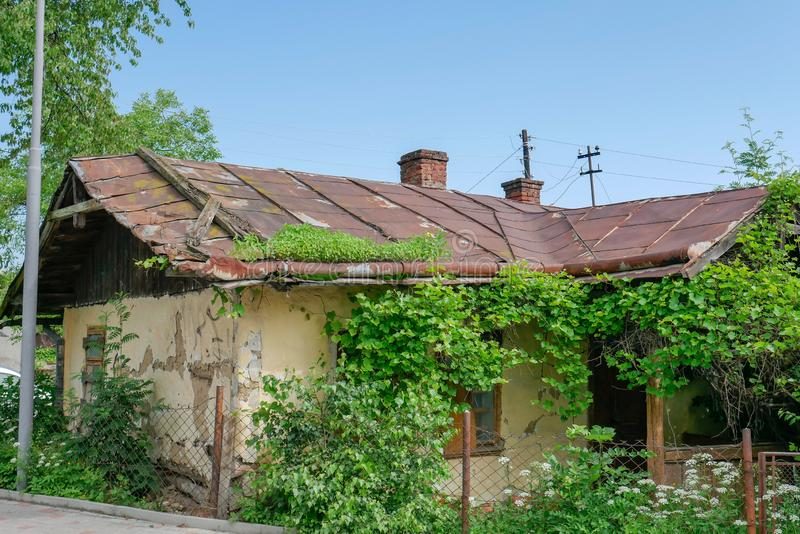 Old abandoned house with a rusty metal roof stock photos