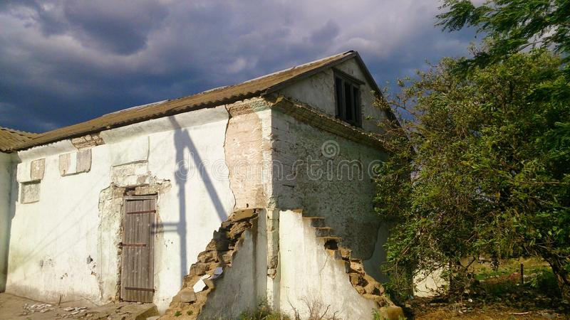 Old abandoned house with trees stock image