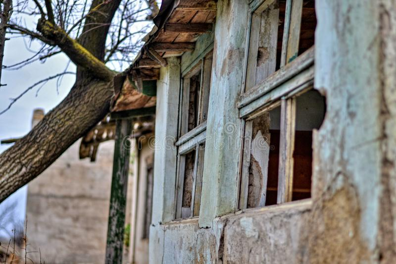 Old and abandoned house where nobody lives stock photo