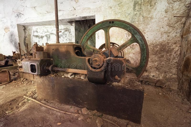 Old abandoned industrial machine tools and rusty metal equipment in abandoned factory. Old abandoned industrial machine tools and rusty metal equipment in royalty free stock images