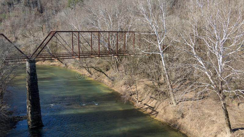Old abandoned iron bridge over locust fork river in warrior alabama. In winter royalty free stock photography