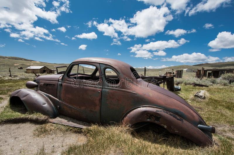 Old abandoned jalopy car sitting in Bodie State Historical Park, a gold rush ghost town.  stock photography