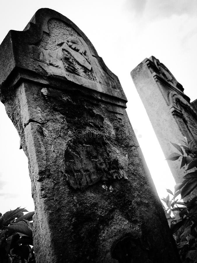 Old abandoned Jewish cemetery with stone graves between trees stock images