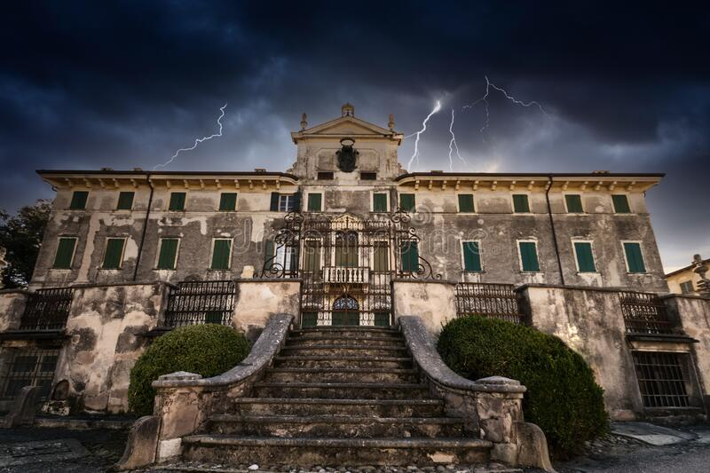 Old abandoned mansion during a frightening storm. Old abandoned mansion during a frightening storm with thunder and lightning royalty free stock images