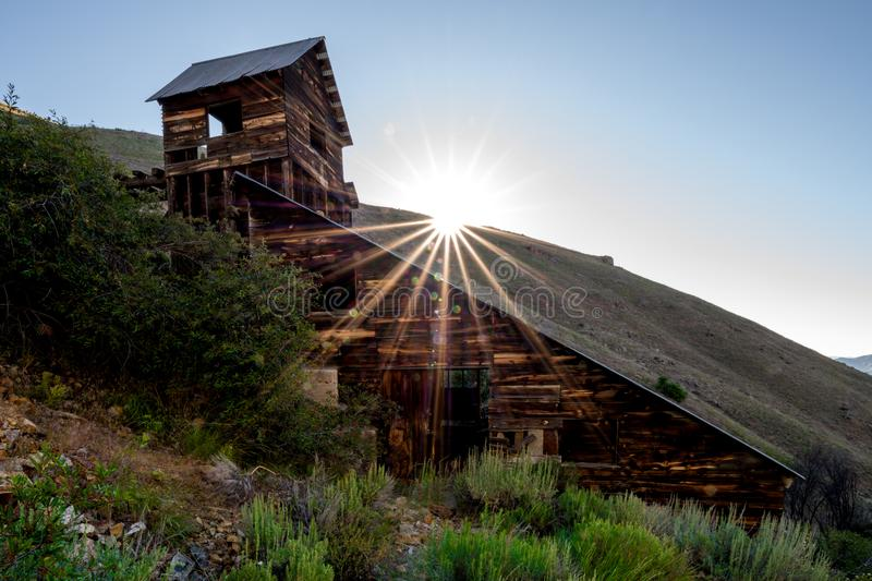 Sun star is formed over the ridge above the Adelmann min in southern Idaho royalty free stock images