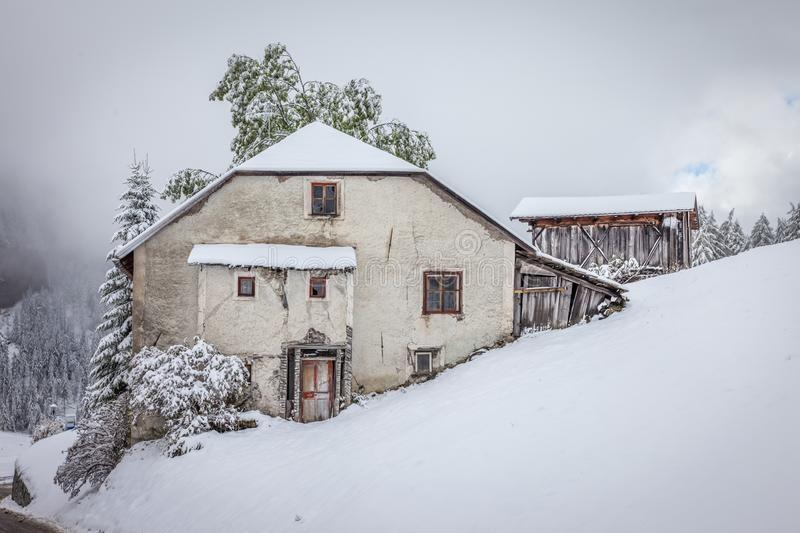 Old, abandoned mountain farm in winter royalty free stock photos