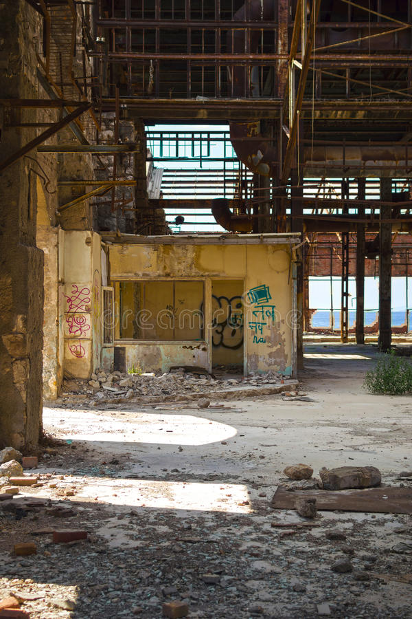 Old abandoned office. View of an old abandoned office in a wrecked industrial building stock photo