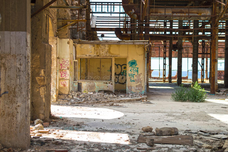 Old abandoned office. View of an old abandoned office in a wrecked industrial building stock photos