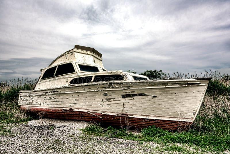Old Abandoned Pleasure Recreational Boat On Land Stock Photo