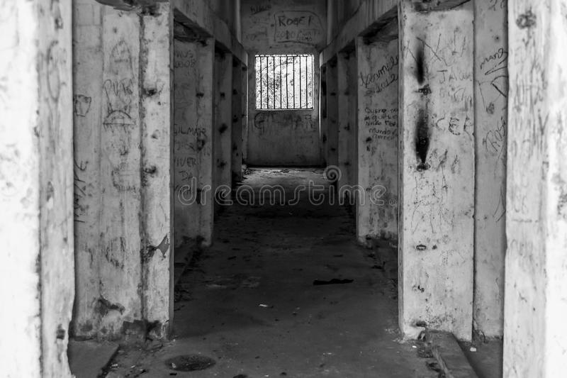 Old abandoned prison hall jail bars. Old abandoned prison hall graffiti jail bars stock image