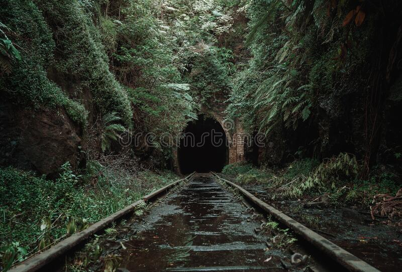 Old, abandoned railway tunnel background royalty free stock images