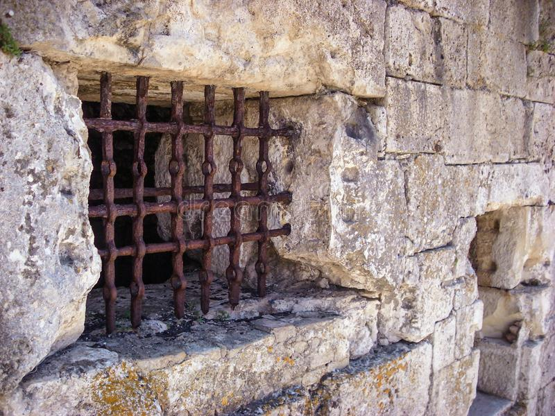 Old, abandoned, rusty jail bars window. Old, abandoned, rusty jail bars window royalty free stock photography