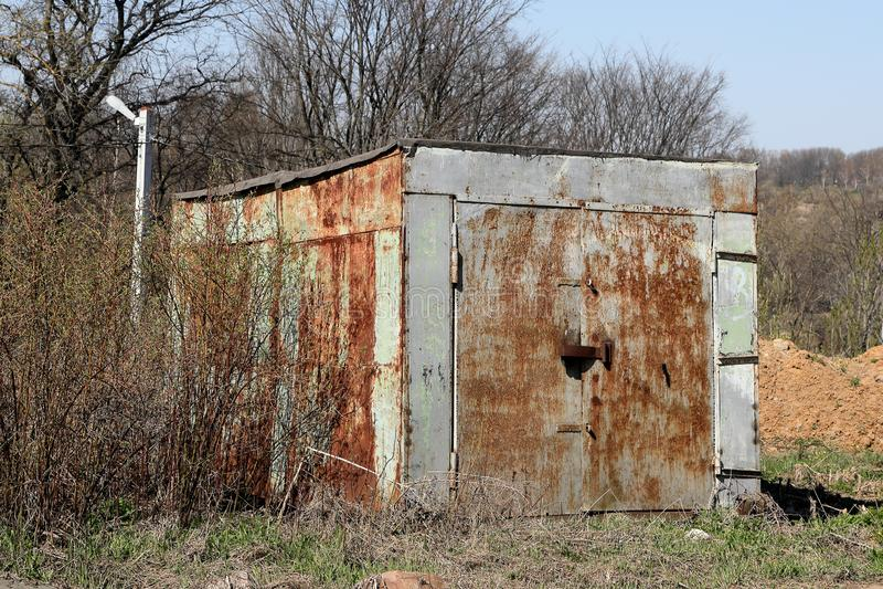 Old abandoned rusty metal garage.  stock image