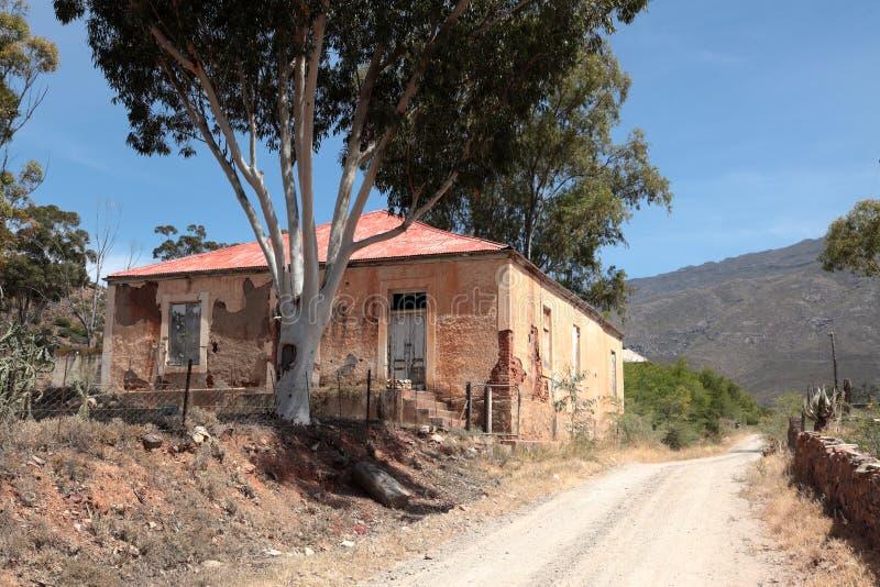 Old abandoned school building in disrepair. stock photo