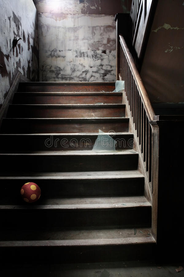 Old abandoned stairs with broken glass and a ball royalty free stock photos