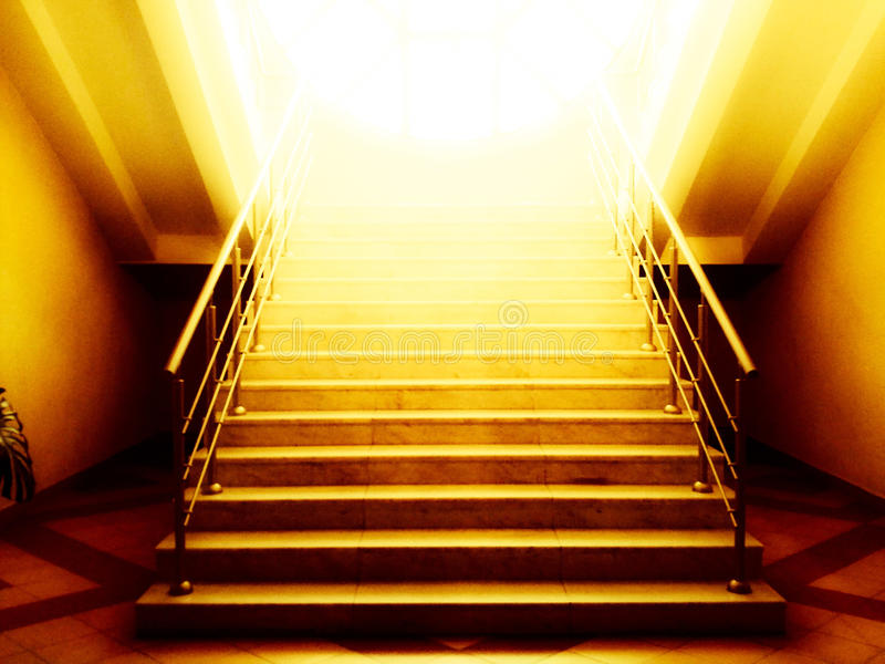 Old abandoned stairs going up to the light. Hope concept.  stock photos